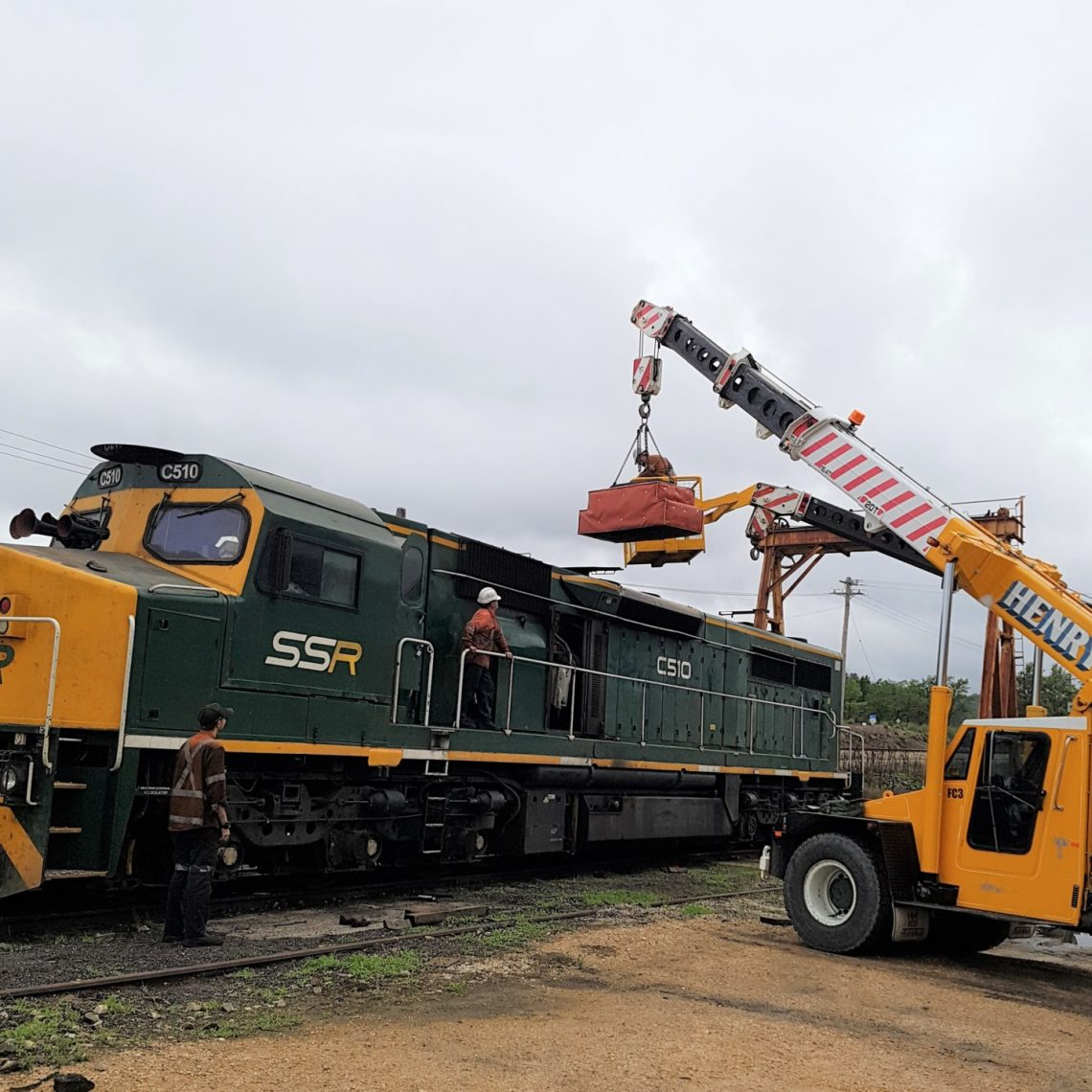 Installation of the custom designed muffler on C Class locomotive